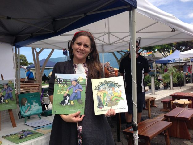 Michelle Worthington with the books 'Each The Same' and 'The Bedtime Band""